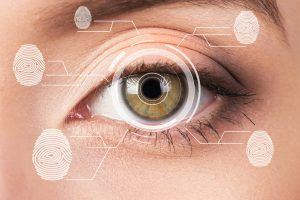 Biometric security retina scanner. Young woman eye fingerprint, imprint.
